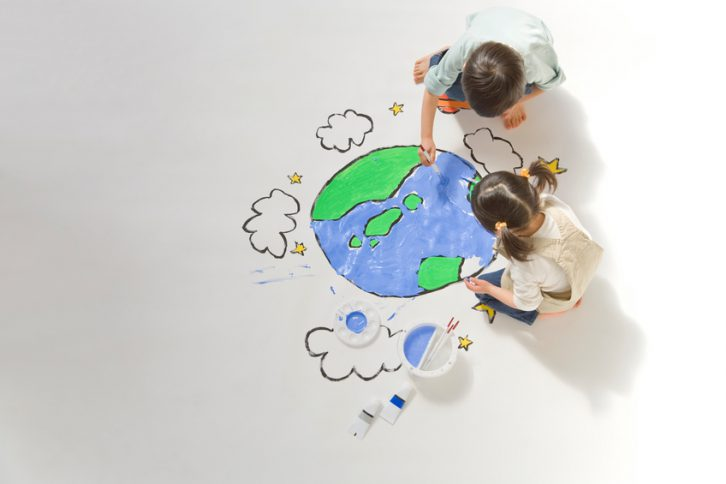 Children drawing a picture of earth