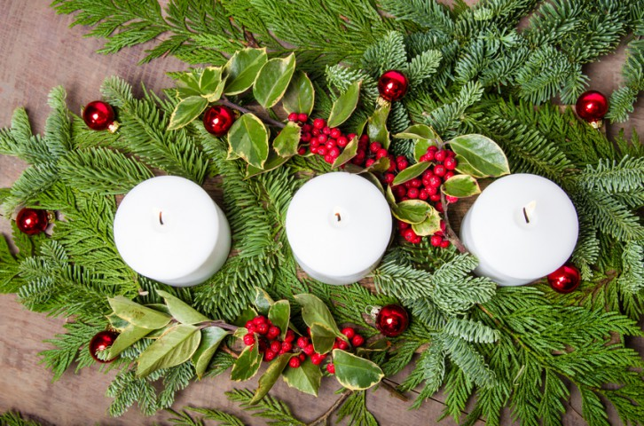 Evergreen Christmas centerpiece with candles
