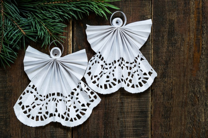 Openwork angels in the art of quilling Christmas decoration